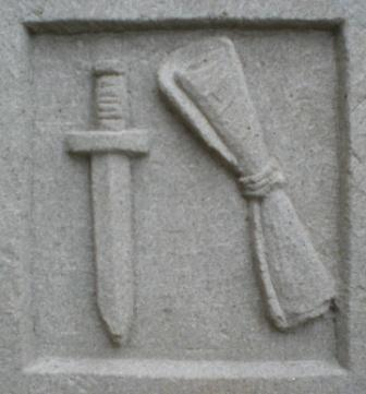 Our logo represents the Attributes of St Paul by Philip Chatfield .  The sword indicating the way he died and the scroll his writings